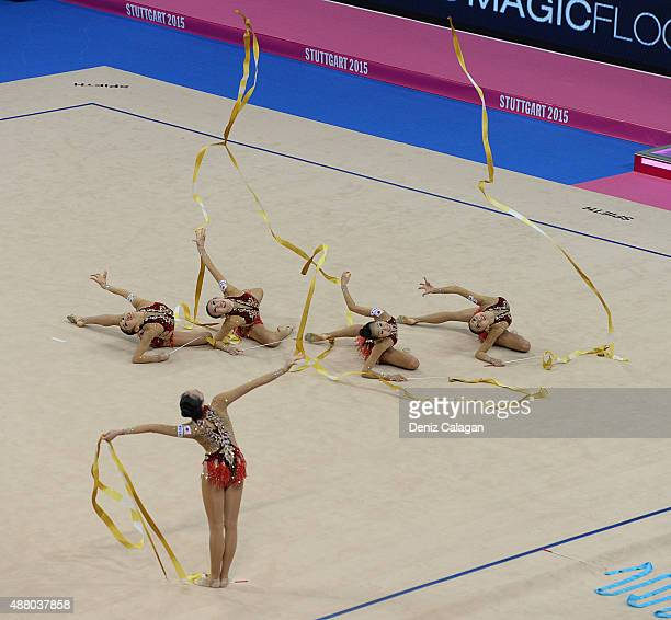 Airi Hatakeyama Mao Kunii Rie Matsubara Sayuri Sugimoto and Kiko Yokota of Japan compete in the Group Apparatus Ribbon Final during day 7 of the...
