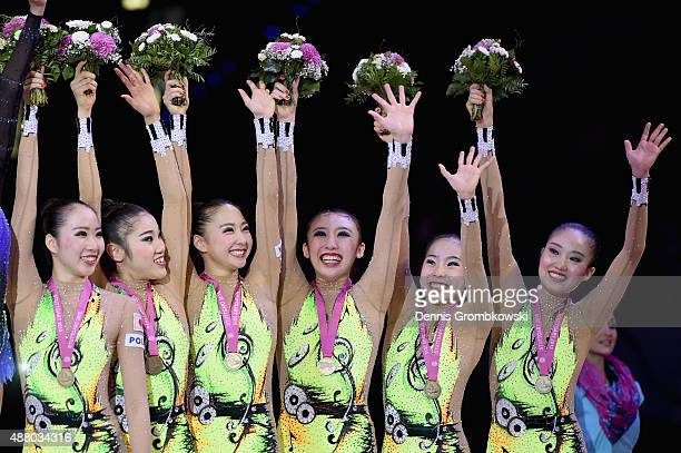 Airi Hatakeyama Mao Kunii Rie Matsubara Sayuri Sugimoto Sakura Noshitani and Kiko Yokota of Japan celebrate at the podium after the Group Apparatus...