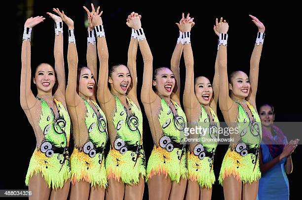 Airi Hatakeyama Mao Kunii Rie Matsubara Sayuri Sugimoto Sakura Noshitani and Kiko Yokota of Japan celebrate at the podium after the Group Apparatus...