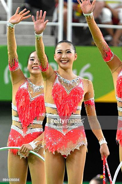 Airi Hatakeyama of Team Japan waves after competing in the Group AllAround Final on Day 16 of the Rio 2016 Olympic Games at Rio Olympic Arena on...