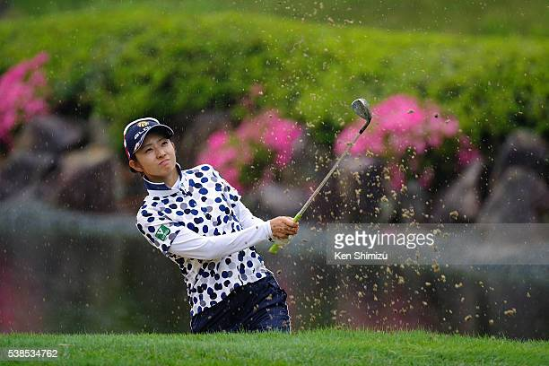 Airi Saito of Japan hits her bunker shot on the 18th hole during the training day of the Suntory Ladies Open at the Rokko Kokusai Golf Club on June 7...