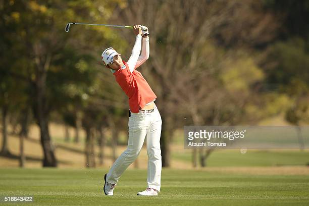 Airi Saito of Japan hits her second shot on the 18th hole during the T-Point Ladies Golf Tournament at the Wakagi Golf Club on March 20, 2016 in...