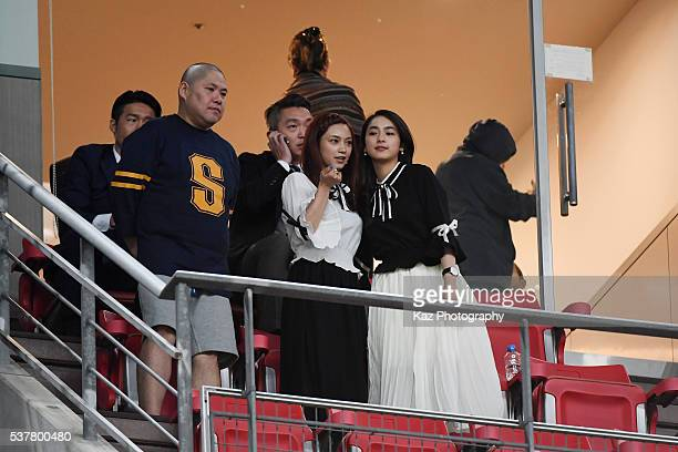 Airi Taira girl friend of Yuto Nagatomo of Japan is seen on the stand with her younger sister Yuna Taira during the international friendly match...