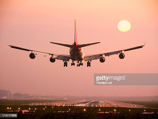 airlane landing into sunrise - air vehicle stock pictures, royalty-free photos & images