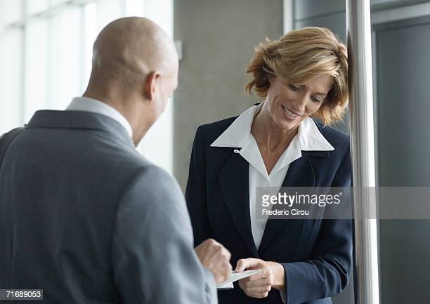 Airline attendant taking businessman's ticket