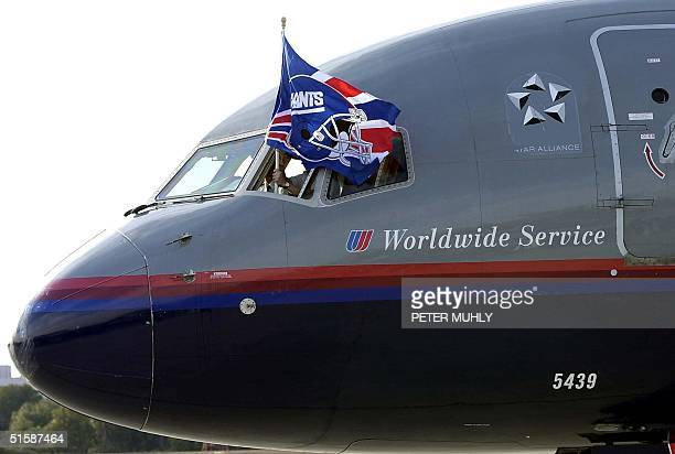 Airline captain Greg Downs flies the New York Giants team flag 21 January 2001 after landing with the team at the Tampa International Airport in...
