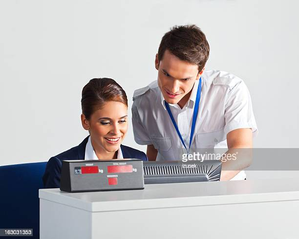 Airline check in attendants at work