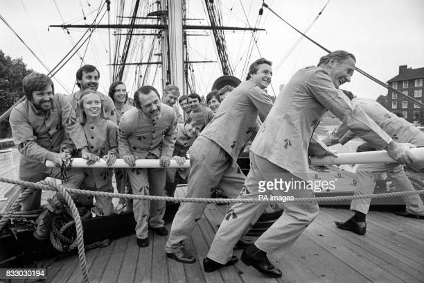 Airline employees in the guise of pre20th Century convicts man the spokes of the capstan aboard the Cutty Sark the tea clipper at London's Greenwich...