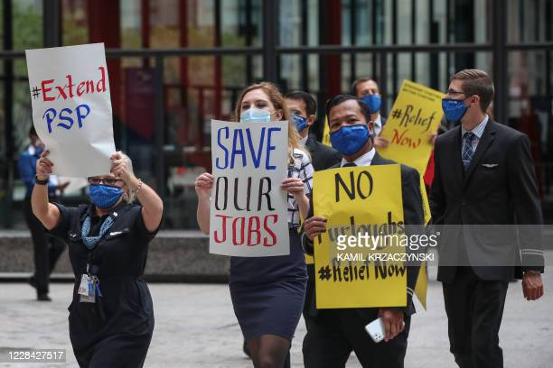 Airline industry workers hold signs during a protest in Federal Plaza in Chicago, Illinois, on September 9, 2020. - Other protests where held in...