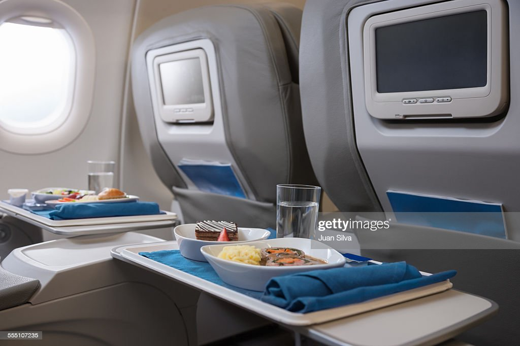 Airline meals served on seat tables : Stock Photo