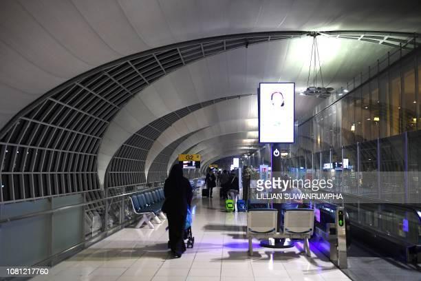 Airline passengers arrive at the departure area of Suvarnabhumi international airport in Bangkok on January 12 2019
