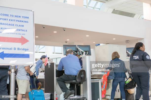 airline passengers at crowded tsa security checkpoint - transportation security administration stock pictures, royalty-free photos & images
