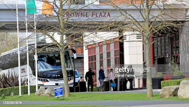 Airline passengers leave the bus to enter the Crowne Plaza hotel to begin their period of quarantine on March 29, 2021 in Dublin, Ireland. Last week,...