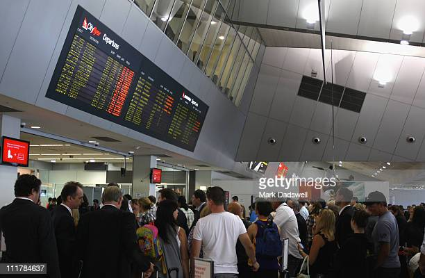 Airline passengers line up to pass through security after a secuity breach at the Qantas domestic terminal of Melbourne Airport on April 7 2011 in...