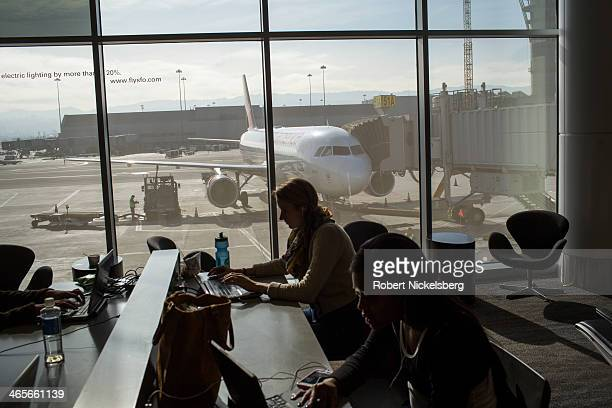 Airline passengers on a Virgin America flight wait in the airport terminal January 12 2014 in San Francisco California