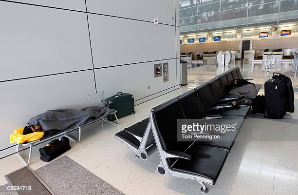 Airline passengers sleep in Terminal D at DFW International Airport on February 1 2011 in Dallas Texas A major ice storm hit the Dallas/Fort Worth...