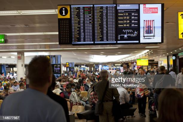 Airline passengers wait for their flight departures July 5 2012 at London England's Heathrow Airport in Terminal 3 Tourism in London is expected to...