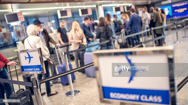 airline passengers waiting in line - lining up stock pictures, royalty-free photos & images