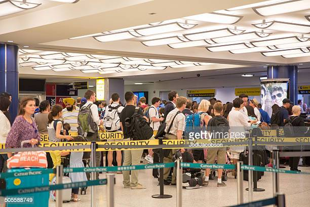Airline passengers waiting in line to pass through airport security