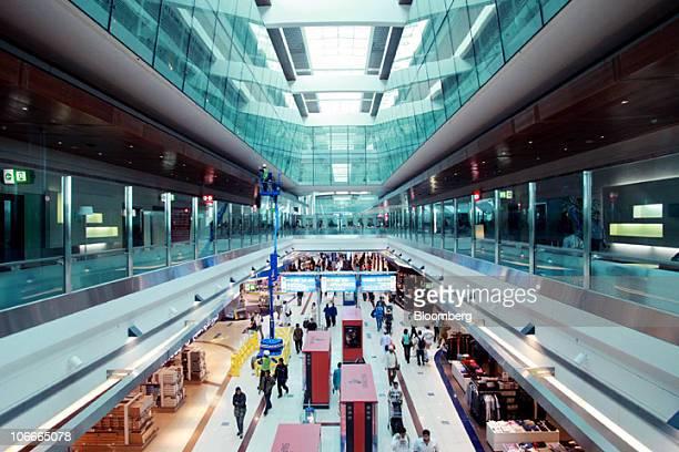 Airline passengers walk through Terminal 3 at the Dubai International Airport in Dubai United Arab Emirates on Tuesday Nov 9 2010 Emirates the...