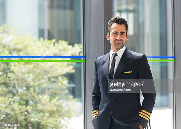 Airline pilot in airport terminal