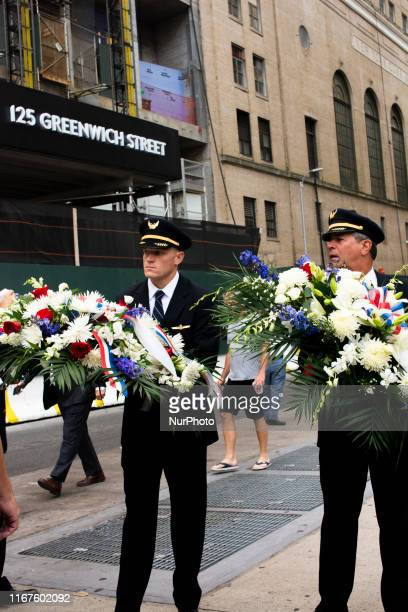 Airline Pilots with memorial flowers entering the September 11 Memorial Service