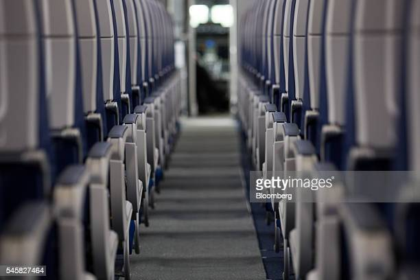 Airline seats line the aisle of a Boeing Co 737 Max aircraft during preparations ahead of the Farnborough International Airshow 2016 in Farnborough...