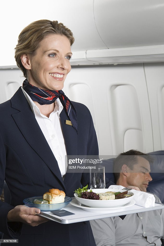 Airline stewardess holding tray : Stock Photo