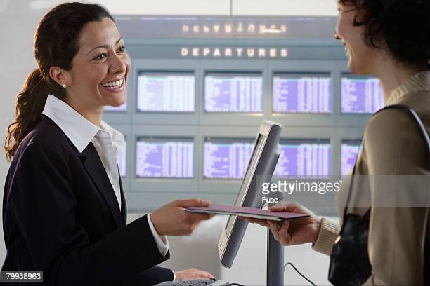 Airline Ticket Agent Assisting Passenger