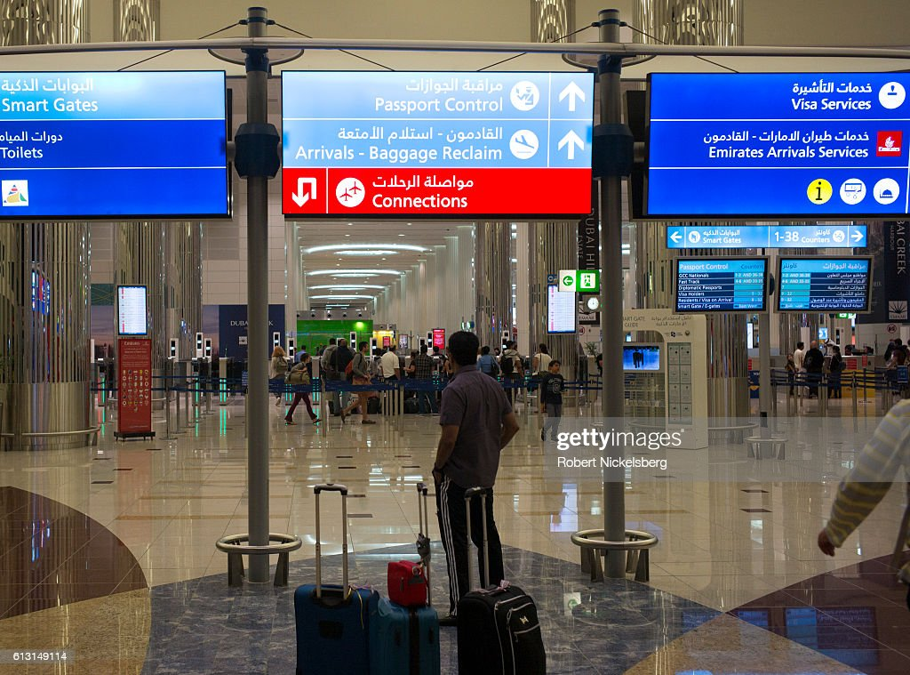 Airline travelers wait to clear immigration control at the Dubai International Airport in the United Arab Emirates on August 25, 2016.
