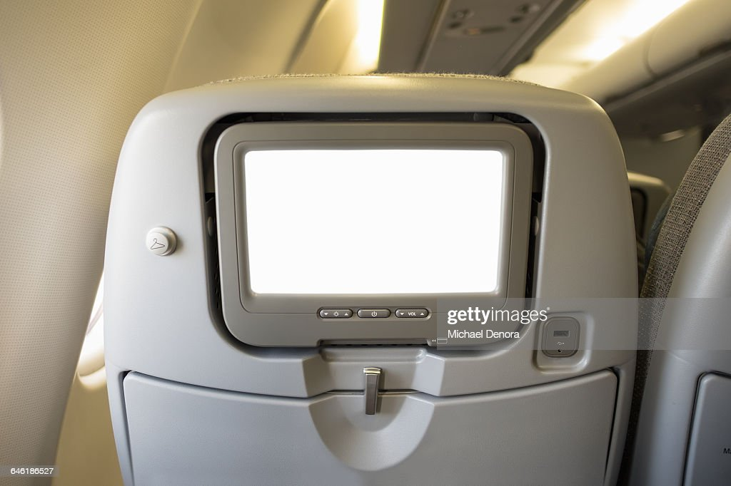 Airline video screen on back of seat : Stock Photo