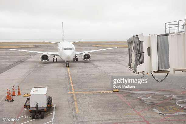 Airliner and passenger gangway on runway, Auckland, North Island, New Zealand