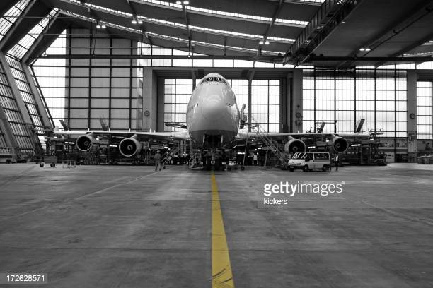 Airliner in hangar - black and white