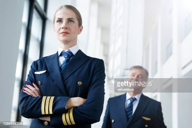 airliner pilots at airport - piloting stock pictures, royalty-free photos & images