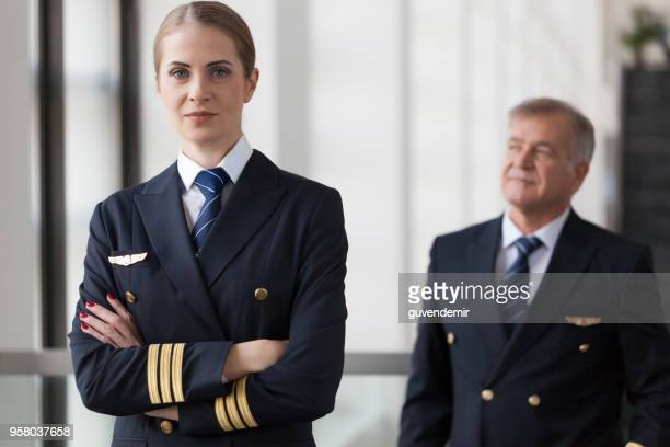 airliner pilots - uniform stock pictures, royalty-free photos & images