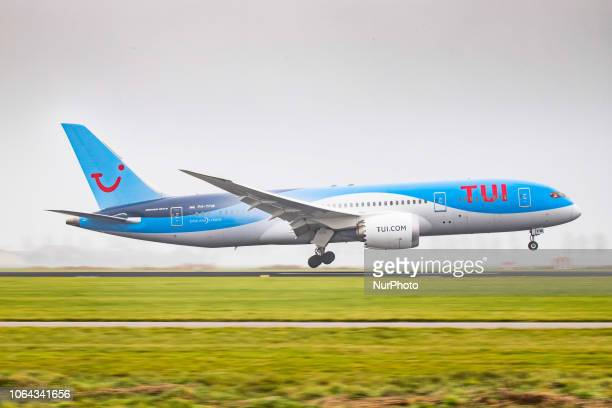 TUI Airlines Netherlands Boeing 7878 Dreamliner landing in the mist in Amsterdam Schiphol International Airport The aircraft registration is PHTFM...