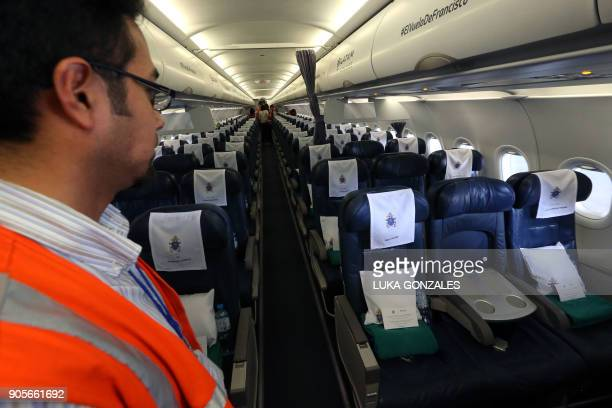 Airlines personnel work in the preparations for the official presentation of the Airbus A319 which will transport Pope Francis during his upcoming...