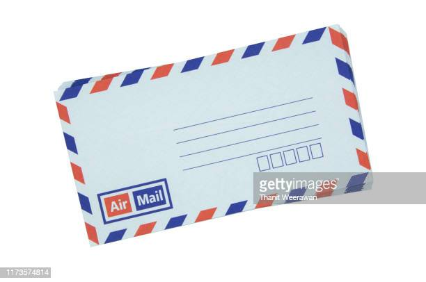 airmail envelope on white background - postcard stock pictures, royalty-free photos & images