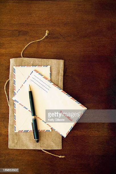 Airmail envelopes on wooden table