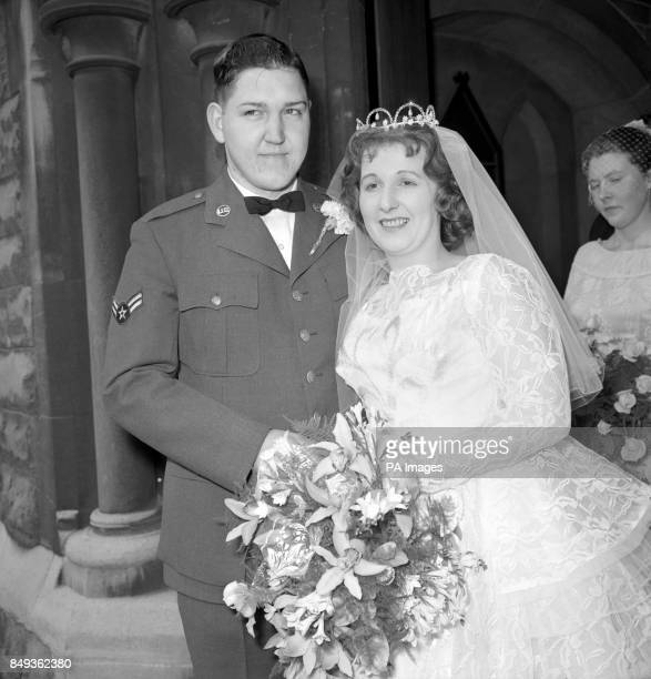 Airman Albert Finlay of the United States Air Force with his bride the former Miss Margaret Harris emerge from a road subway at Hammersmith Broadway...