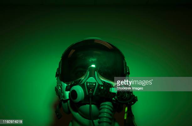 airman donning flight helmet and night vision goggles. - aviation hat stock photos and pictures