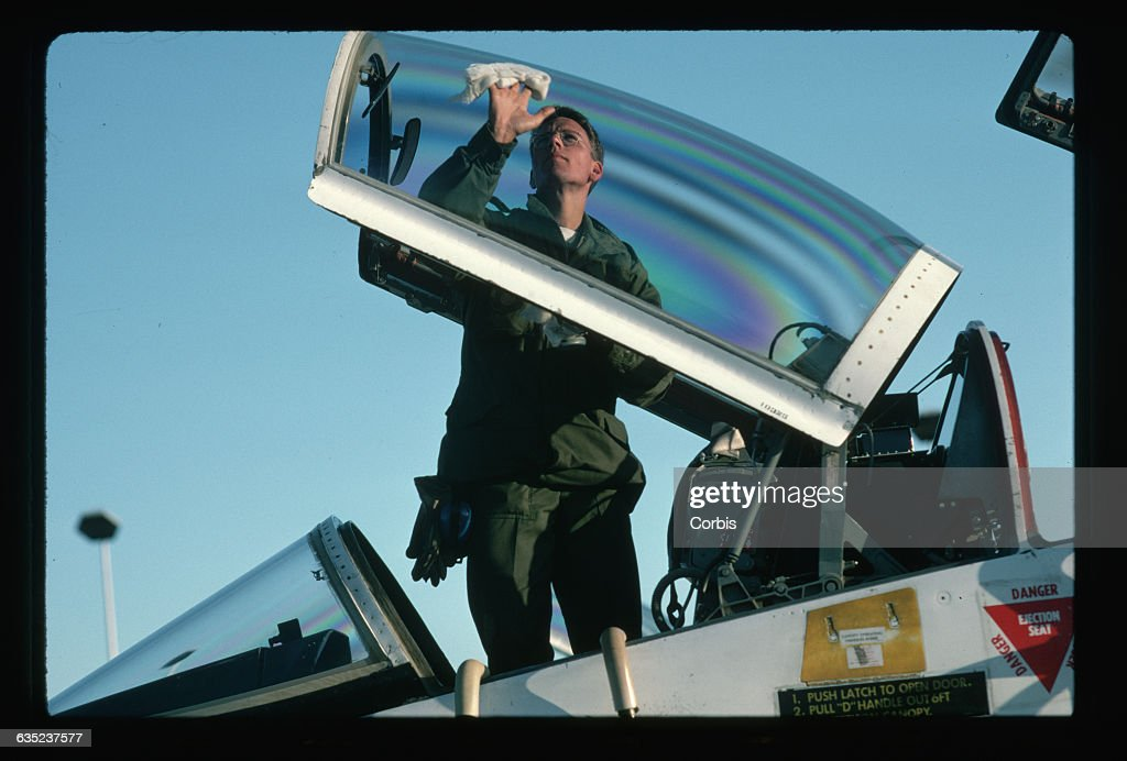 Airman First Class Mark Nowotny cleans the canopy of a T-38A jet trainer at & Mechanic Cleaning a Jet Canopy Pictures | Getty Images