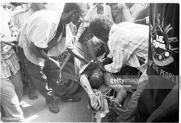 A US airman from a downed Black Hawk is seized and killed in Mogadishu's main square October 1993 Shortly after this picture was taken the airman's...