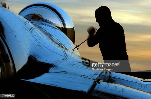 airman tightens down an f-16 fighting falcon canopy after a periodic inspection at nellis air force base, nevada. the u.s. air force thunderbirds perform more than 65 shows annually across the united states and abroad. - air force thunderbirds stock pictures, royalty-free photos & images