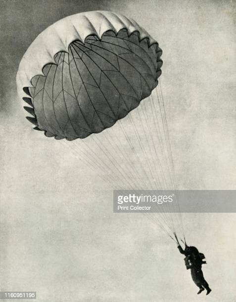 Airman using a parachute during the Second World War 1941 'The free parachute type is standardised in the RAF and with it parachutist jumps with the...