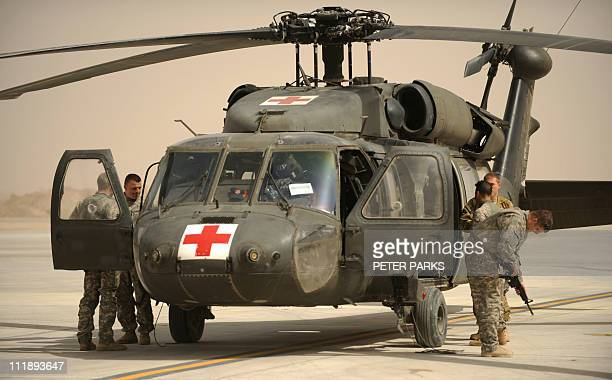 US airmen from Company C 1st Battalion 52nd Aviation Regiment MEDEVAC unit disembark from their Blackhawk helicopter after a mission at Kandahar...