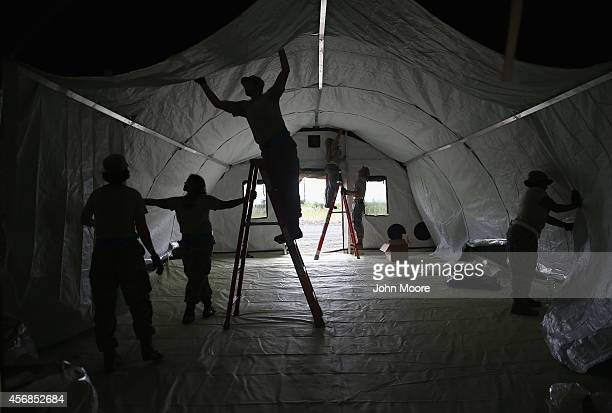 Airmen from the 633rd Medical Group of the US Air Force set up tents for a 25bed hospital to aid Liberian health workers infected with Ebola on...
