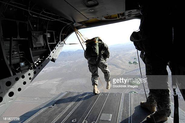 u.s. airmen jump from a ch-47 chinook over nevada. - ch 47 chinook stock photos and pictures
