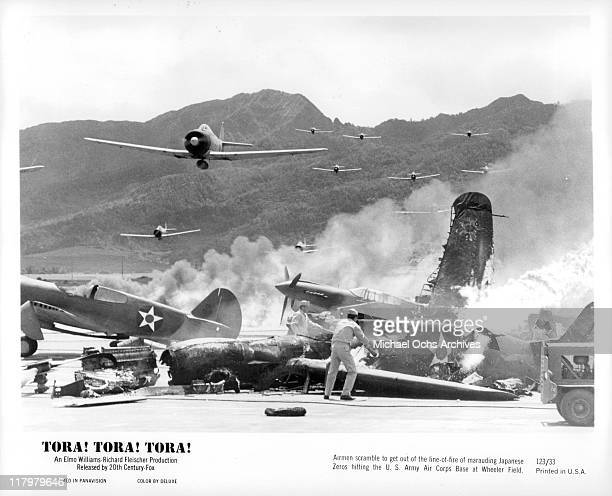 Airmen scramble to get out of the way of marauding Japanese Zeros in a scene from the film 'Tora Tora Tora' 1970