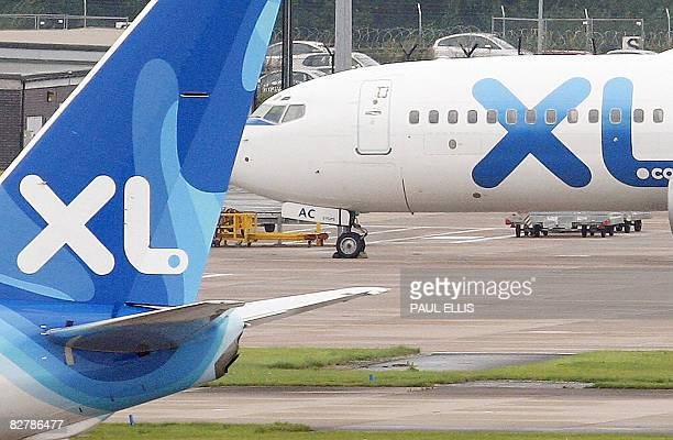Airplaines from Britain's third largest tour operator, XL Leisure Group, which operates XL Airways, sit at Manchester Airport in Manchester,...